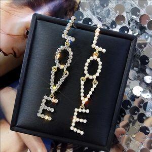 Love Gold Tone Long Earrings